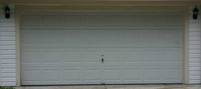 You Should Be Seeing A Picture Of A Pretty Garage Door.